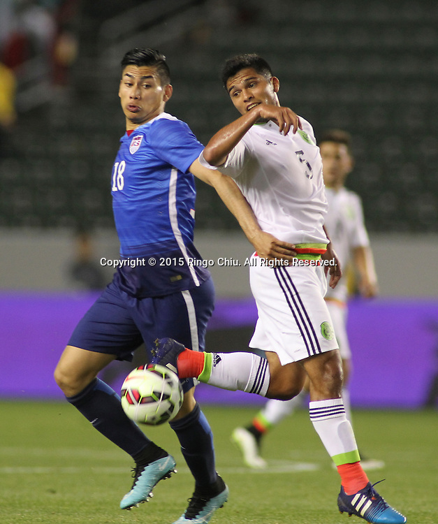 United States' Mario Rodriguez #18 actions against Mexico's Jorge Caballero #5 during a men's national team international friendly match, April 22, 2015, at StubHub Center in Carson, California. United States won 3-0. (Photo by Ringo Chiu/PHOTOFORMULA.com)