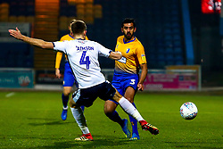 Will Aimson of Bury attempts to cut out a pass by Malvind Benning of Mansfield Town - Mandatory by-line: Ryan Crockett/JMP - 04/12/2018 - FOOTBALL - One Call Stadium - Mansfield, England - Mansfield Town v Bury - Checkatrade Trophy