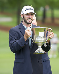 May 5, 2019 - Charlotte, North Carolina, United States of America - Max Homa raises the trophy after winning the 2019 Wells Fargo Championship at Quail Hollow Club on May 05, 2019 in Charlotte, North Carolina. (Credit Image: © Spencer Lee/ZUMA Wire)