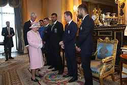 Queen Elizabeth II meets England cricket captain Eoin Morgan (second right), Afghanistan captain Gulbadin Naib (left), Australia captain Aaron Finch (second left), Bangladesh captain Masrafe Bin Mortaza (third left) and India captain Virat Kohli (right). The captains of the teams taking part in the ICC Cricket World Cup meet for a photograph in the 1844 Room at Buckingham Palace in London, ahead of the competition's Opening Party on the Mall.