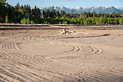 "View shows a section of the Flathead Lake lakebed that has been ""restored"" after damage by heavy machinery.  Destruction of the lakebed and the resulting loss of scenic value to the area caused by construction of a private bridge to Dockstader Island on the north shore of Flathead Lake in Bigfork, Montana, in violation of the state's Lakeshore Protection Act, as photographed on May 20, 2015."