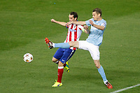 Atletico de Madrid´s Diego Godin (L) and Malmo´s  during Champions League soccer match between Atletico de Madrid and Malmo at Vicente Calderon stadium in Madrid, Spain. October 22, 2014. (ALTERPHOTOS/Victor Blanco)