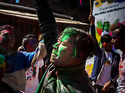 "12 MARCH 2017 - BHAKTAPUR, NEPAL: People celebrate Holi in ""Pottery Square"" in Bhaktapur by throwing colorful powder on each other and dousing each other with water. Holi, a Hindu religious festival, has become popular with non-Hindus in many parts of South Asia, as well as people of other communities outside Asia. The festival signifies the victory of good over evil, the arrival of spring, end of winter, and for many a festive day to meet others. Holi celebrations in Nepal are not as wild as they are in India.     PHOTO BY JACK KURTZ"