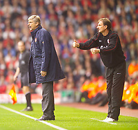 Photo. Jed Wee.<br /> Liverpool v Arsenal, FA Barclaycard Premiership, Anfield, Liverpool. 04/10/03.<br /> Arsenal manager Arsene Wenger (L) and Liverpool assistant manager Phil Thompson try to urge greater effort from their charges.
