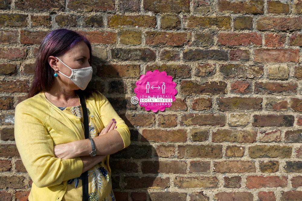 Woman making face mask during Coronavirus pandemic, UK September 2020. MR