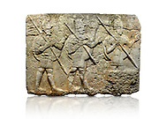 Hittite monumental relief sculpted orthostat stone panel from the Herald's Wall. Basalt, Karkamıs, (Kargamıs), Carchemish (Karkemish), 900-700 B.C. Military parade. Anatolian Civilisations Museum, Ankara, Turkey. Two helmeted soldiers in short skirts carry the shield on their backs and the spears in their hands.  <br /> <br /> Against a white background. .<br />  <br /> If you prefer to buy from our ALAMY STOCK LIBRARY page at https://www.alamy.com/portfolio/paul-williams-funkystock/hittite-art-antiquities.html  - Type  Karkamıs in LOWER SEARCH WITHIN GALLERY box. Refine search by adding background colour, place, museum etc<br /> <br /> Visit our HITTITE PHOTO COLLECTIONS for more photos to download or buy as wall art prints https://funkystock.photoshelter.com/gallery-collection/The-Hittites-Art-Artefacts-Antiquities-Historic-Sites-Pictures-Images-of/C0000NUBSMhSc3Oo
