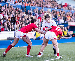 Jess Breach of England is tackled by Keira Bevan of Wales<br /> <br /> Photographer Simon King/Replay Images<br /> <br /> Six Nations Round 3 - Wales Women v England Women - Sunday 24th February 2019 - Cardiff Arms Park - Cardiff<br /> <br /> World Copyright © Replay Images . All rights reserved. info@replayimages.co.uk - http://replayimages.co.uk