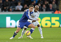 Chelsea's Eden Hazard vies for possession with Swansea City's Dwight Tiendalli<br /> <br /> Photographer /Ashley CrowdenCameraSport<br /> <br /> Football - Barclays Premiership - Swansea City v Chelsea - Saturday 17th January 2015 - Liberty Stadium - Swansea<br /> <br /> © CameraSport - 43 Linden Ave. Countesthorpe. Leicester. England. LE8 5PG - Tel: +44 (0) 116 277 4147 - admin@camerasport.com - www.camerasport.com