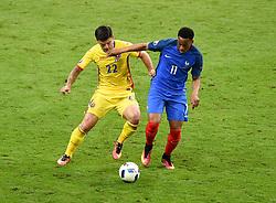 Anthony Martial of France battles for the ball with Cristian Sapunaru of Romania  - Mandatory by-line: Joe Meredith/JMP - 10/06/2016 - FOOTBALL - Stade de France - Paris, France - France v Romania - UEFA European Championship Group A