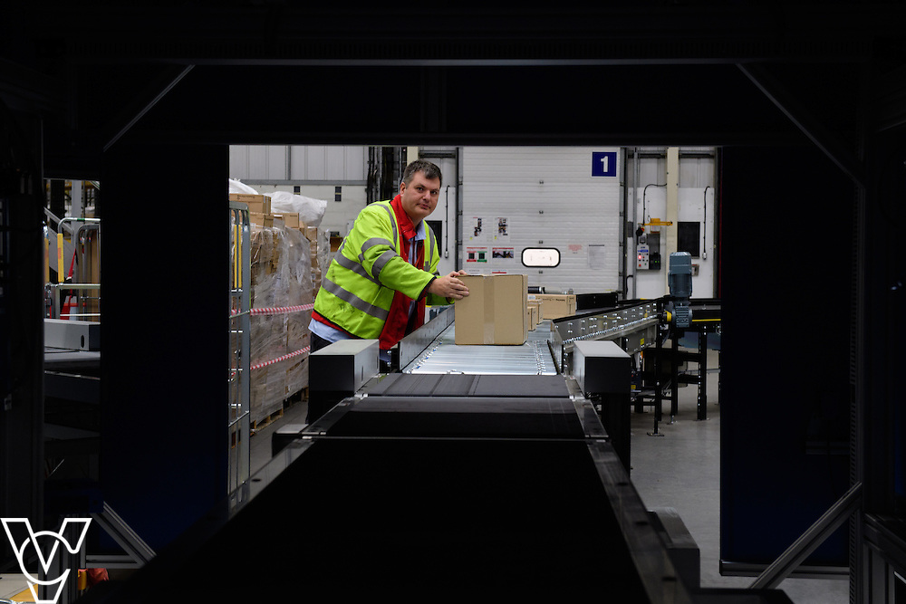 Royal Mail's Yorkshire Distribution Centre has got a new parcel scanning machine installed, part of a £1.7m investment in distribution centres, which helps increase the number of parcels scanned in a day.  Pictured is the new parcel scanning machine at the Yorkshire Distribution Centre.  Pictured is the new machine scanning parcels loaded onto it by Richard Beck.<br /> <br /> Picture: Chris Vaughan Photography<br /> Date: November 14, 2016
