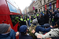 © Licensed to London News Pictures. 20/03/2021. London, UK. Police clash with protesters on Piccadilly during a Rally for Freedom in central London, to protest against the continued lockdown restrictions imposed to fight the spread of coronavirus. Similar events are taking place at cities around the world. Photo credit: Ben Cawthra/LNP