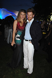 TOM AIKENS and his wife AMBER at the annual Serpentine Gallery Summer Party in association with Swarovski held at the gallery, Kensington Gardens, London on 11th July 2007.<br /><br />NON EXCLUSIVE - WORLD RIGHTS