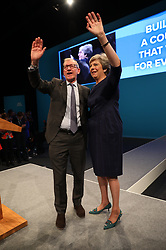 © Licensed to London News Pictures . 04/10/2017. Manchester, UK. Theresa May and Philip May hug after the speech . Prime Minister THERESA MAY delivers her keynote speech on the fourth and final day of the Conservative Party Conference at the Manchester Central Convention Centre . Photo credit: Joel Goodman/LNP