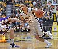 WICHITA, KS - JANUARY 05:  Guard Fred VanVleet #23 of the Wichita State Shockers brings the ball up court against the Northern Iowa Panthers during the first half on January 5, 2014 at Charles Koch Arena in Wichita, Kansas.  (Photo by Peter G. Aiken/Getty Images) *** Local Caption *** Fred VanVleet