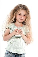 caucasian little girl portrait holding milk glass isolated studio on white background