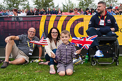 Lee Valley Athletic Centre, London, September 11th 2014. Competitor Stuart Robinson from the Royal Air Force Regiment watches the action with his wife Amy, Father-in-Law Dave Peasgood and son George.