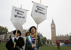 "© licensed to London News Pictures. London, UK 24/10/2012. Members of UK Feminista walking in Parliament Square with placards reading ""Deeds not Words"" as UK Feminista members meet for a mass lobby with Dr Helen Pankhurst, granddaughter of Emmeline Pankhurst and calling on MPs to stop erosion of women's rights and drive forward progress on women's equality. Photo credit: Tolga Akmen/LNP"