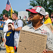 "Person protesting the staging of the ""Restoring Honor"" rally on the date of MLK's famous civil rights March on Washington. Conservative television commentator Glenn Beck's ""Restore Honor"" conservative rally at the Lincoln Memorial on the National Mall, held on the 47th anniversary of Dr. Martin Luther King's famous ""I Have a Dream"" civil rights speach of 1963. Speakers from the stage erected on the lower steps of the Lincoln Memorial included Beck himself along with former vice presidential candidate Sarah Palin."