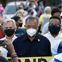Rev. JESSE JACKSON leads marchers as voting rights  groups march toward the Texas Capitol from north Austin on the third day of a 30-mile journey protesting Republican efforts to suppress votes nationwide and in Texas. Shifts of marchers trade off in an effort to combat oppressive Texas heat. At left is Austin Mayor Steve Adler.