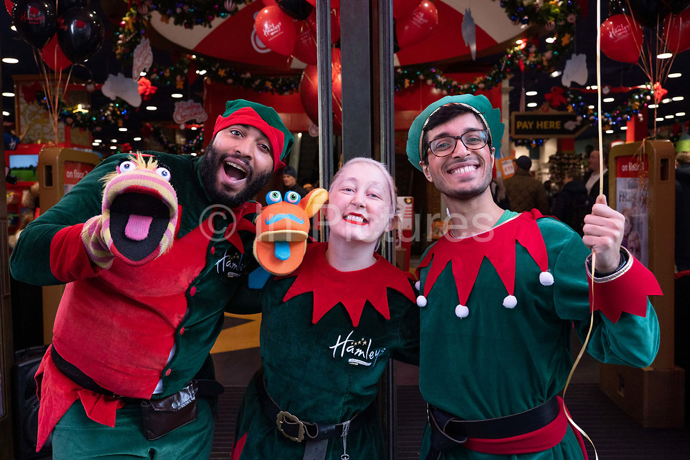Promotional staff dressed as Elves outside the flagship Hamleys children's shop on Regent Street for the Black Friday on the 29th November 2019 in central London in the United Kingdom. Black Friday is a shopping event that originated from the US where retailers cut prices on the day after the Thanksgiving holiday.
