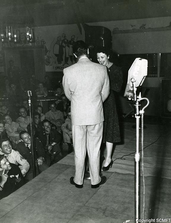 1945 Bob Hope & Vera Vague entertain soldiers at the Hollywood Canteen