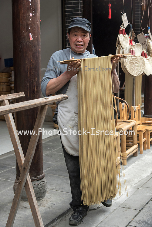 making noodles at the food market in Chengdu, Sichuan, China