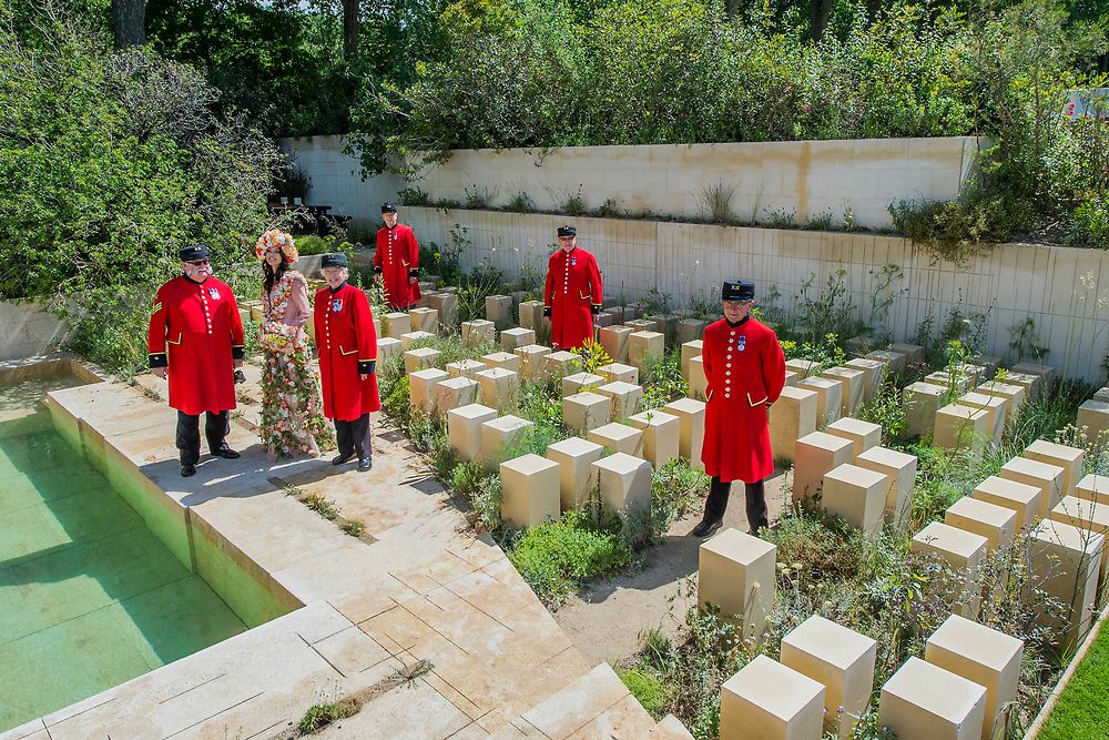 Bruna Miranda in a flower dress on the M&G garden with Chelsea Pensioners - The Chelsea Flower Show organised by the Royal Horticultural Society with M&G as its main sponsor for the final year. London 22 May, 2017