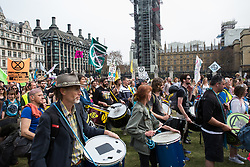 London, UK. 23rd April 2019. The XR Samba Band marches into Parliament Square with fellow climate change activists from Extinction Rebellion for an assembly and the preparation of letters requesting meetings with Members of Parliament.
