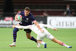 March 9, 2019 - Vancouver, BC, U.S. - VANCOUVER, BC - MARCH 09:  Robbie Fergusson (4) of Scotland is tackled by Dan Bibby (7) of England during day 1 of the 2019 Canada Sevens Rugby Tournament on March 9, 2019 at BC Place in Vancouver, British Columbia, Canada. (Photo by Devin Manky/Icon Sportswire) (Credit Image: © Devin Manky/Icon SMI via ZUMA Press)