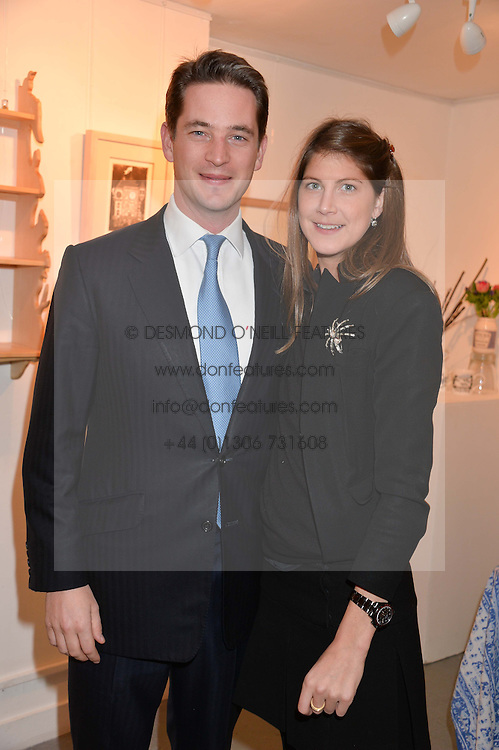 The HON.JAMES TOLLEMACHE and PRINCESS FLORENCE VON PREUSSEN at an exhibition of works by Beatrice von Preussen held at The Gallery on The Corner, 155 Battersea Park Road, London SW8 on 11th December 2013.
