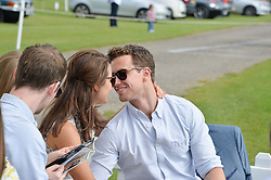 SAMANTHA BARKS and RICHARD FLEESHMAN share a kiss at the St.Regis International Polo Cup at Cowdray Park, Midhurst, West Sussex on 17th May 2014.