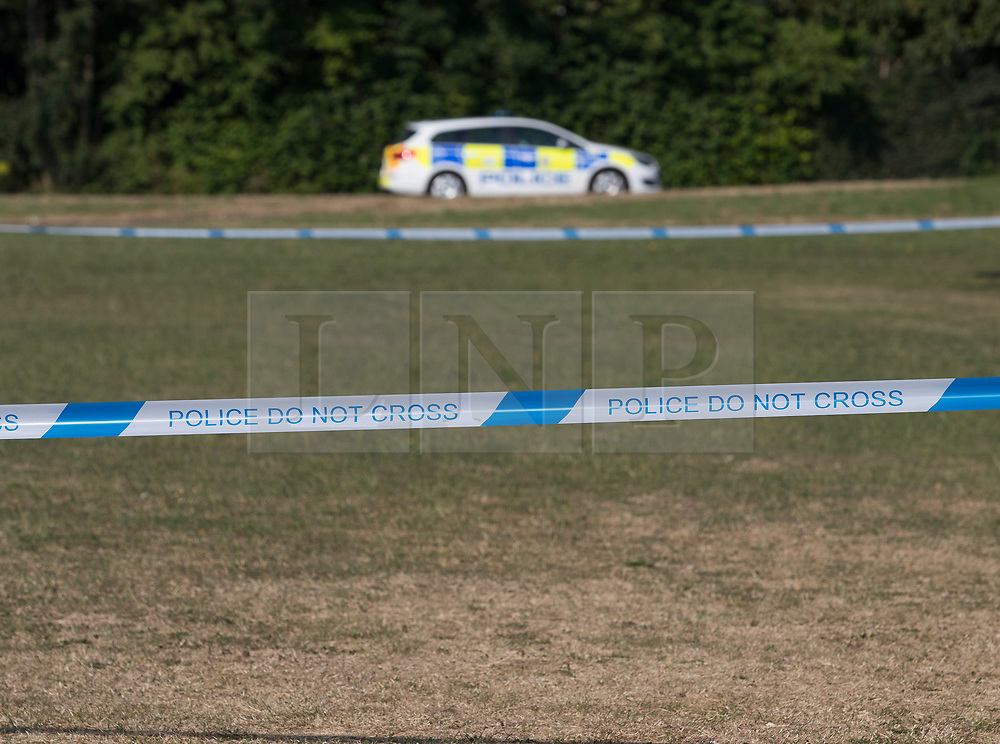 © Licensed to London News Pictures. 04/07/2018. Amesbury, UK. A police car sits near a cordoned off area on the village green at Raleigh Crescent, Amesbury where it is thought  Dawn Sturgess, 44, and her partner Charlie Rowley, 45, may have visited for a family fun day before they were taken ill on Saturday 30th June 2018. Police have confirmed that the couple have been in contact with Novichok nerve agent. Former Russian spy Sergei Skripal and his daughter Yulia were poisoned with Novichok nerve agent in nearby Salisbury in March 2018. Photo credit: Peter Macdiarmid/LNP