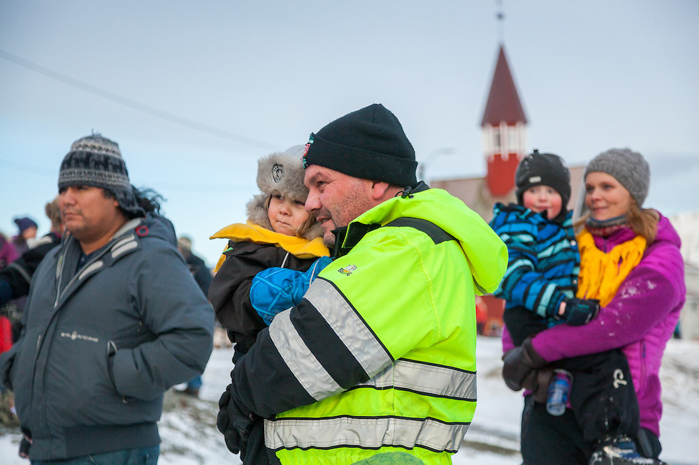 Parents in the audience hold their children at SolFest in Longyearbyen, Svalbard. The festival marks the official arrival of the sun to the town – by tradition, to the old hospital steps (sykehustrappa).