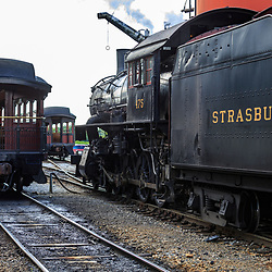 Strasburg, PA / USA - June 27, 2017:  A steam locomotive moves through the yard at the Strasburg Rail Road station.