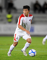 La Roche sur Yon FC Nantes v Korea  DPR (0-0) 09/10/2009<br /> Pak Nam Chol  DPR Korea<br /> North Korea make a rare appearance in the West having already qualified for World Cup 2010. Their last appearance in a major competiition was World Cup 1966 when they famously knocked Italy out of the tournament.<br /> Photo Roger Parker Fotosports International