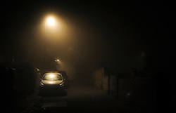 © Licensed to London News Pictures. 20/11/2011. Saltburn, England. A car on a side-street in Saltburn is illuminated by a single street light as it shines through heavy fog. Photo credit : Ian Forsyth/LNP