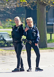 ©Licensed to London News Pictures 26/03/2020<br /> Greenwich, UK. Two police officers having a selfie moment. People get out and about in Greenwich Park, Greenwich, London this afternoon as they make the most of their permitted one a day exercise out of the house from Coronavirus Lockdown. The Prime Minister Boris Johnson has asked people to stay at home to help in the fight against Covid-19. Photo credit:LNP
