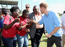 Prince Harry meets school girls as he attends a youth sports festival at the Sir Vivian Richards Stadium in North Sound, Antigua, on the second day of his tour of the Caribbean.