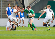 Ireland centre Conor O'Brien hands off England flanker Will Evans during the World Rugby U20 Championship Final   match England U20 -V- Ireland U20 at The AJ Bell Stadium, Salford, Greater Manchester, England onSaturday, June 25, 2016. (Steve Flynn/Image of Sport)
