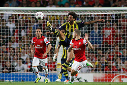 27.08.2013, Emirates Stadion, London, ENG, UEFA CL Qualifikation, FC Arsenal vs Fenerbahce Istanbul, Rueckspiel, im Bild Fernerbache's Cristian defending with a high kick during the UEFA Champions League Qualifier second leg match between FC Arsenal and Fenerbahce Istanbul at the Emirates Stadium, United Kingdom on 2013/08/27. EXPA Pictures © 2013, PhotoCredit: EXPA/ Mitchell Gunn<br /> <br /> ***** ATTENTION - OUT OF GBR *****