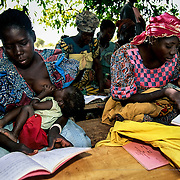 Education plays a fundamental role in eradicating the practice of female circumcision. The Kobinkalé association, with support from Intermón Oxfam, takes advantage of the adult literacy programme to spread awareness among the population. Boulgou, Burkina Faso.