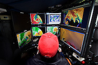 Alex Gibbs, a graduate student at the University of Nebraska, operates the computers controlling the weather radar inside the Doppler on Wheels truck in Salina, Kansas, June 3, 2009.  The DOW trucks are participating in Project Vortex 2.<br /> <br /> Project Vortex 2 is a two year National Science Foundation funded science mission to study tornadoes and supercell thunderstorms.