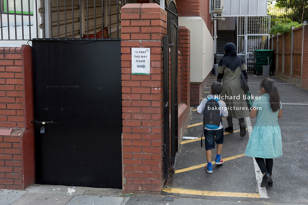 Following the attack on a group of Muslim men outside the Finsbury Park mosque which killed one person and seriously injured another ten, a Muslims enter the Islamic building to pray during disruption, on 19th June 2017, in the borough of Islington, north London, England.