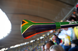 June 11, 2010 - Johannesburg, GAUTENG, SOUTH AFRICA - A fan blows a vuvuzela during the first game of the 2010 FIFA World Cup which had host nation South Africa playing Mexico to a 1-1 draw Friday, June 11, 2010 at Soccer City in Johannesburg, South Africa. Photo by Bahram Mark Sobhani (Credit Image: © Mark Sobhani/ZUMApress.com)