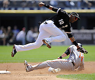 CHICAGO - JULY 19:  Alexei Ramirez #10 of the Chicago White Sox leaps but cannot catch the ball as Nolan Reimold #14 of the Baltimore Orioles steals second base in the second inning on July 19, 2009 at U.S. Cellular Field in Chicago, Illinois.  The Orioles defeated the White Sox 10-2.  (Photo by Ron Vesely)