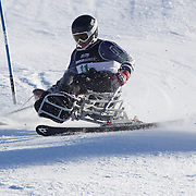 in action during the Men's Slalom Sitting, Adaptive Slalom competition at Coronet Peak, New Zealand during the Winter Games. Queenstown, New Zealand, 25th August 2011. Photo Tim Clayton