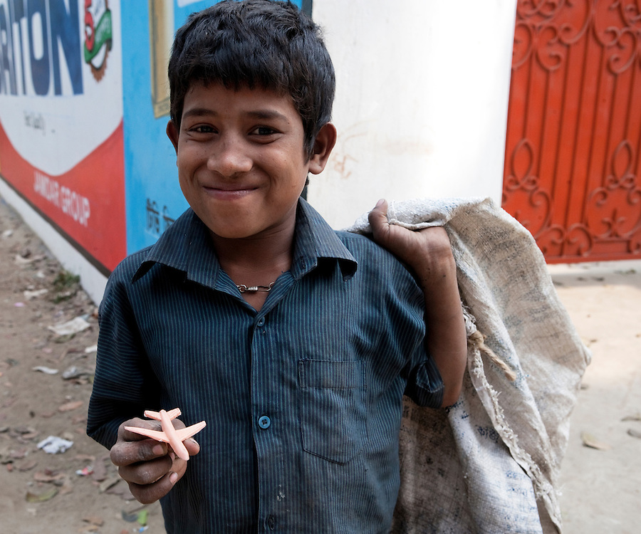 Happy boy in asia with a toy plastic aeroplane