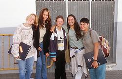 Group of teenage girls carrying school bags and folders in Gran Canaria Spain,