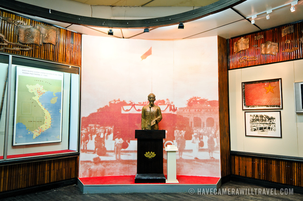 An exhibit of Ho Chi Minh giving a speech, with his statue at a podium against a wall-sized photograph. The Museum of the Vietnamese Revolution in the Tong Dan area of Hanoi, not far from Hoan Kiem Lake, was established in 1959 and is devoted to the history of the socialist revolutionary movement in Vietnam.