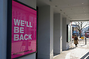 As the number of UK Coronavirus cases rose to over 8,000, it was announced that thousands of 15-minute home tests could be made available within days to those self-isolating with symptoms. A digital billboard tells theatregoers at the Old Vic theatre that they will be back, at Waterloo, on 25th March 2020, in London, England.